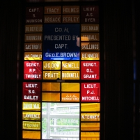Soldiers' names in stained glass.